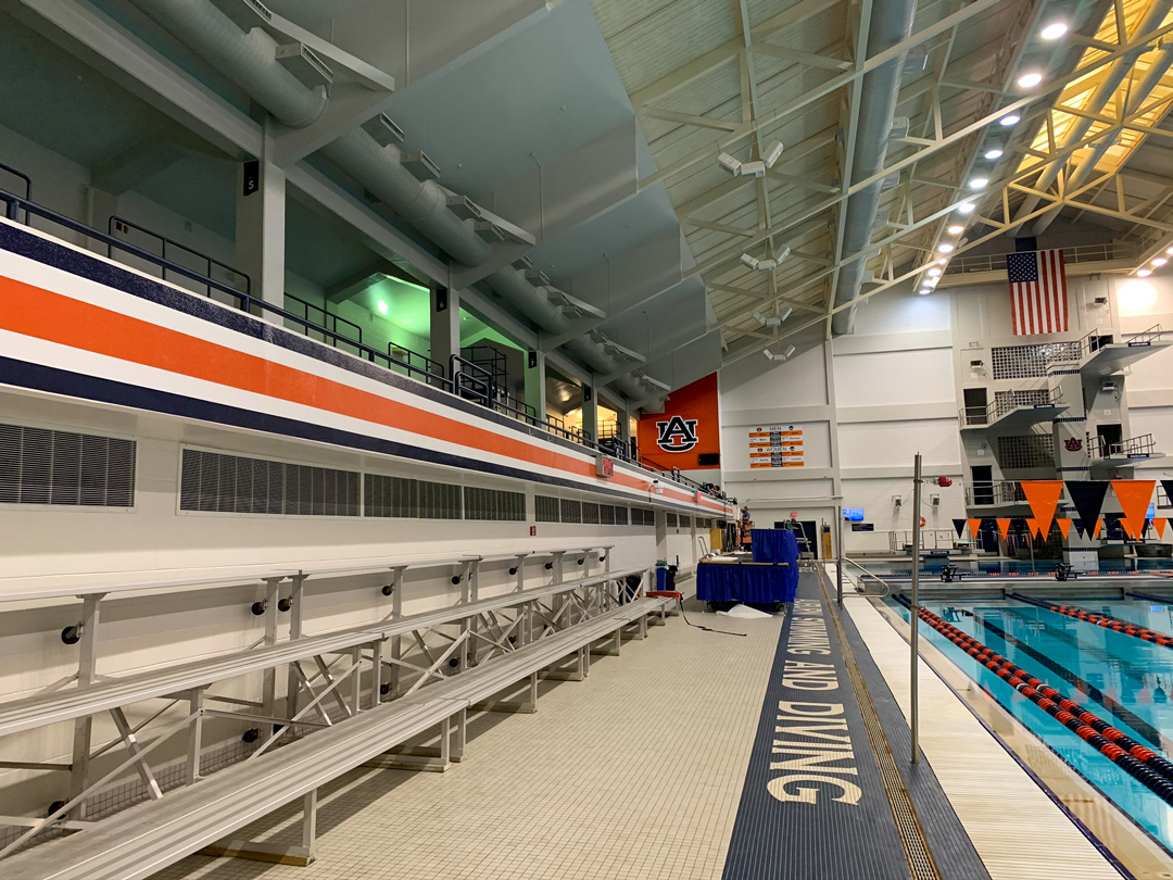 Dimensional Auburn logo and power stripe in the pool deck of the Auburn Aquatics Center designed by Formula Design