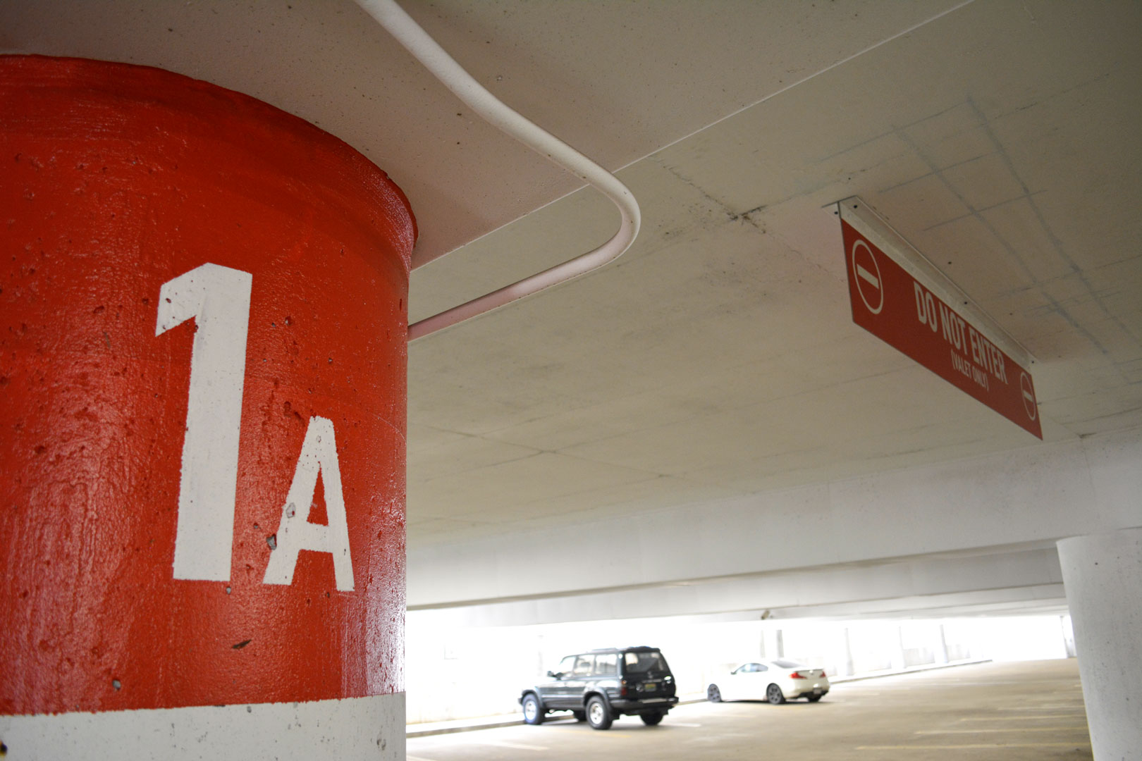 Painted column ID and overhead traffic control signage in the 22nd street BJCC parking deck