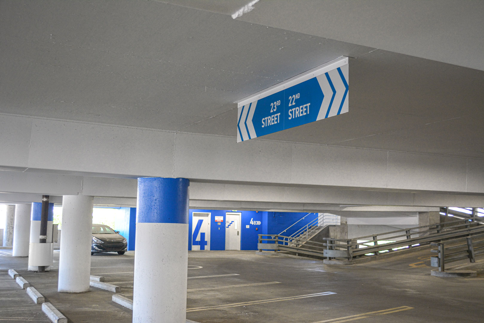 Overhead directional signage and elevator lobby with large level ID graphics in the 22nd street BJCC parking deck