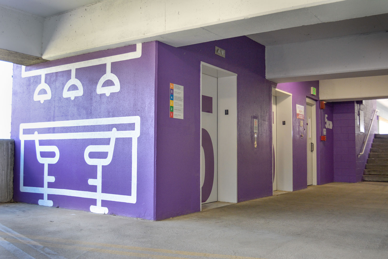 Painted environmental graphics on painted elevator lobby with large level ID graphics in the 22nd street BJCC parking deck