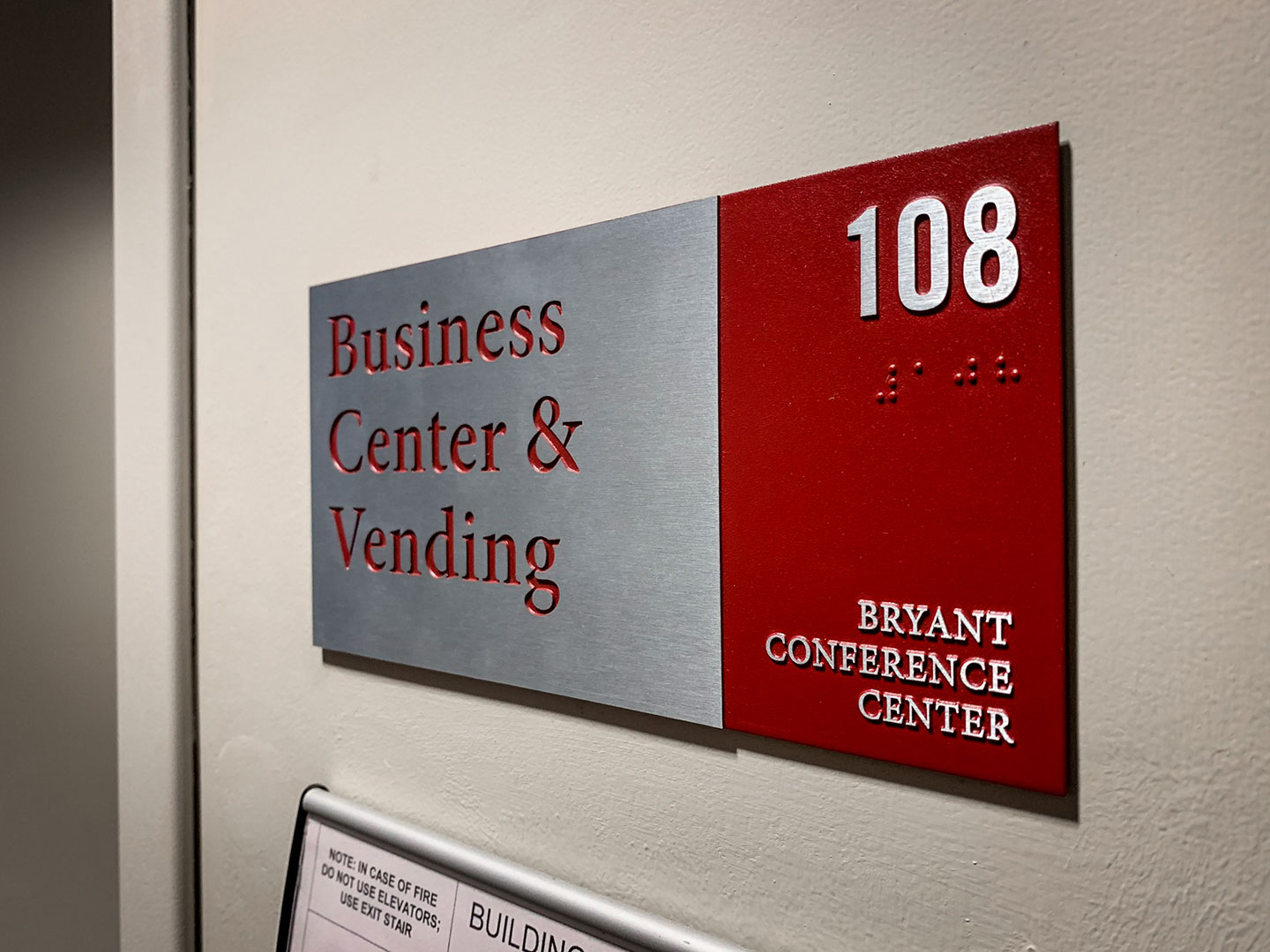 Branded ADA room identification signage at the Bryant Conference Center