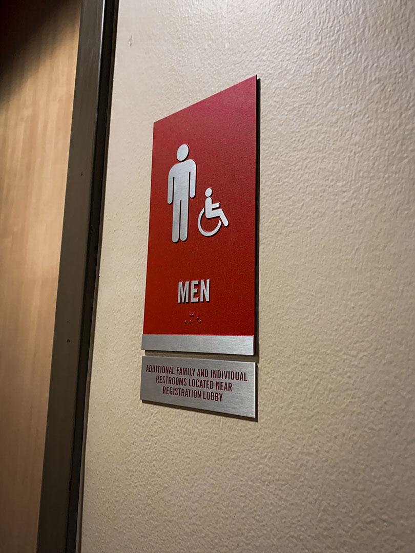 Zinc ADA men's restroom signage for Bryant Conference Center