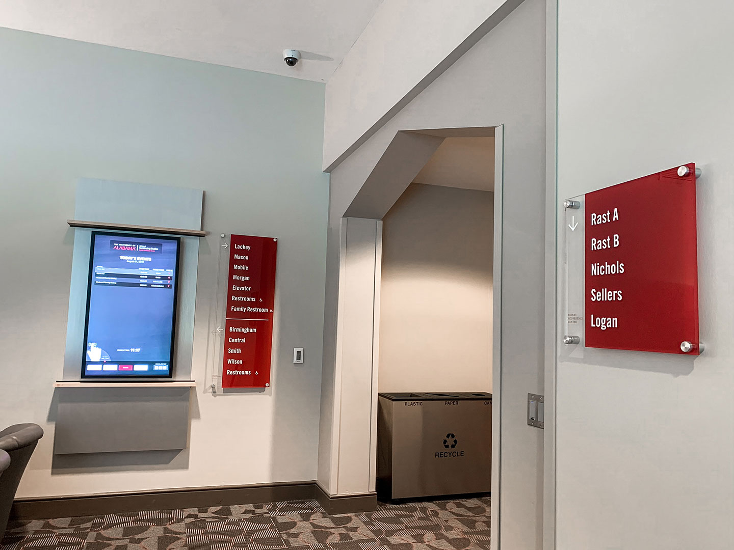 Example of how multiple sign types can frame a decision point at the Bryant Conference Center