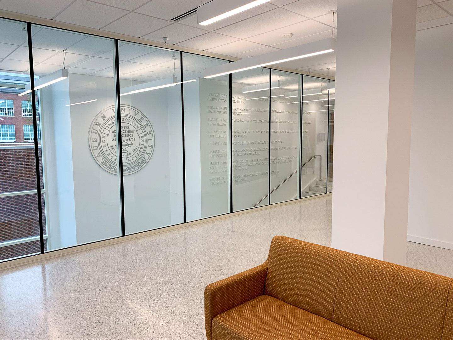 Dimensional Auburn creed wall and university seal through glass wall