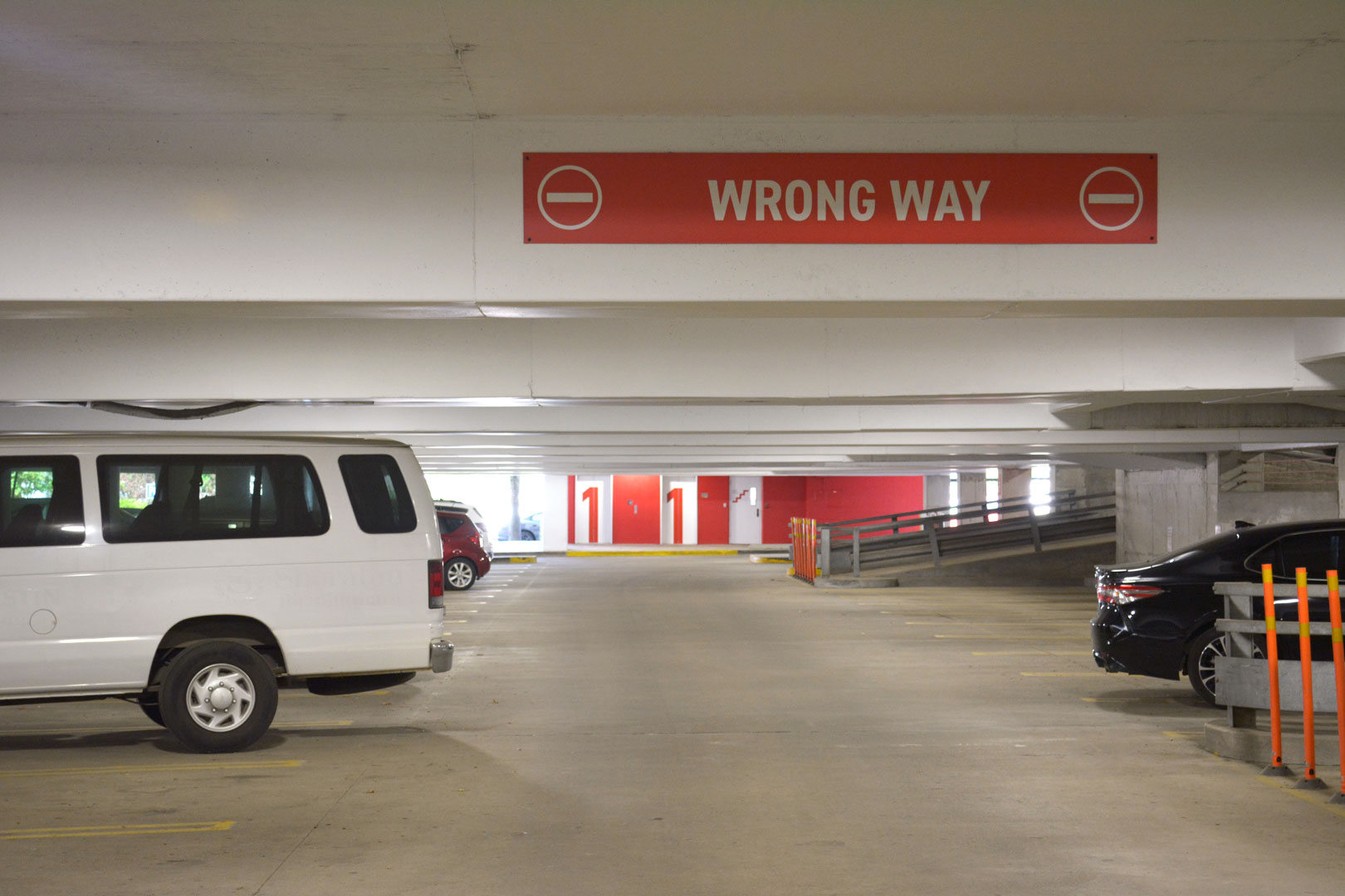 Overhead traffic control signage and elevator lobby with large level ID graphics in the 22nd street BJCC parking deck